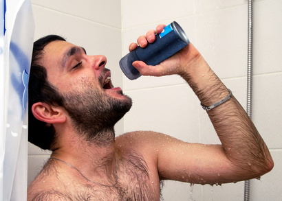 man sings in the shower