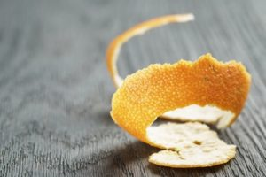 tangerine peel on old wood table, shallow focus